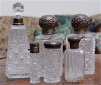Sale 8963H - Lot 35 - A collection of silver mounted and cut glass perfume bottles (some faults), Tallest 16cm