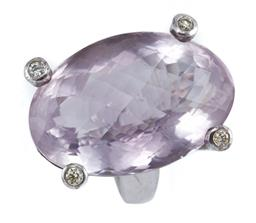 Sale 9095 - Lot 359 - AN AMETHYST AND DIAMOND COCKTAIL RING; centring a large oval chequerboard cut amethyst (31 x 21mm) of 56ct, the supporting claws eac...