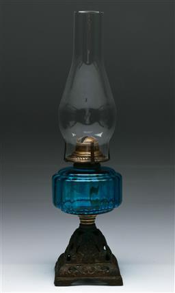 Sale 9148 - Lot 59 - Blue glass kerosene lamp on cast iron base