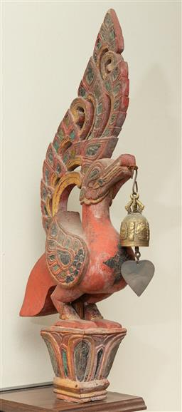 Sale 9164H - Lot 25 - An antique carved Thai Garuda bird with bell and glass inlays, height 50cm x 17cm