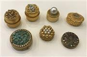 Sale 8436A - Lot 25 - A group of seven gold tone vintage stone encrusted pill boxes including Schildkraut and Florenza.