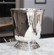 Sale 8782A - Lot 69 - A Christofle (Paris) silver plated swirled and faceted champagne bucket on lipped foot. 24cm high x 21cm diameter.