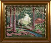 Sale 8804A - Lot 191 - A framed hand worked tapestry depicting wildflowers and lodge within a forest, 30 x 40cm