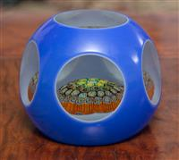 Sale 8963H - Lot 37 - a Murano millefiori paperweight, the blue double overlay cut back with lenses, Height 7cm