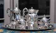 Sale 8782A - Lot 70 - A four piece silver plated tea and coffee service together with a two handled tray and associated hot water jug by Hecworth. Length...