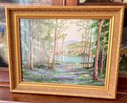 Sale 8804A - Lot 192 - A framed hand worked tapestry depicting a lakeside village viewed from a forest clearing, 30 x 40cm