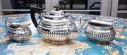 Sale 8782A - Lot 111 - An empire silver plated three piece tea set comprising teapot, milk and sugar. Length of teapot.29cm