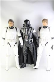 Sale 8827T - Lot 666 - A Darth Vader Figurine together with Han Solo and Luke Skywalker (each missing right hands) h. 80cm