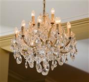 Sale 8430 - Lot 73 - Centre of lounge room – A ten branch two tier Swarovski crystal drop chandelier. Drop 95cm.