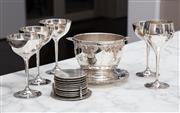 Sale 8782A - Lot 101 - A silver plated footed ice bucket and stand together with five silver plated goblets and a set of Strachan place mats.