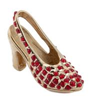 Sale 8937 - Lot 341 - AN 14CT GOLD SHOE CHARM; set with red pastes, 20mm, wt. 2.38g.