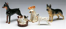 Sale 9153 - Lot 80 - A group of ceramic dog figures incl Beswick Dalmatian (L: 11cm), Beswick German Shepherd (L:18cm) and Royal Doulton Doberman (L: 18cm)