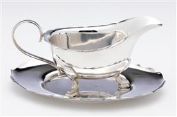 Sale 9245R - Lot 57 - A Hardy Brothers silverplate Chippendale border gravy jug, raised on 3 pad foot legs, on the matching oval tray. Tray L: 17cm x 12cm