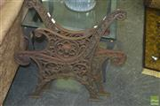 Sale 8331 - Lot 1067 - Pair of Iron Bench Ends