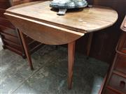 Sale 8868 - Lot 1145 - Rustic Elm Pembroke Table, forming an oval top, raised on tapering legs