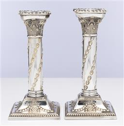 Sale 9245R - Lot 58 - A pair of antique silverplate Corinthian column candlesticks, C: 1900, the column embossed with wrythen leaves, the square base embo...