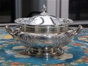 Sale 8782A - Lot 73 - A silver plated twin handled tureen with embossed and hand chased floral decoration and lidded finial. Prouds, height 22cm x width 34cm