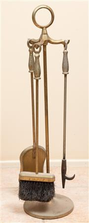 Sale 9071H - Lot 30 - A brass set of firetools