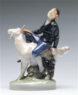 Sale 9173 - Lot 19 - A Royal Copenhagen figure of A man riding A goat (H 18cm)