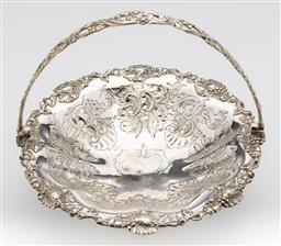 Sale 9245R - Lot 59 - An antique English silverplate swing handle fruit basket C: 1860. The shield decorated well scrolling to a grape and vine border to ...