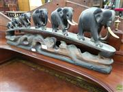 Sale 8634 - Lot 1067 - Ebony Elephant Bridge, of graduated size (some losses to tusks)