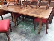 Sale 8868 - Lot 1103 - Antique Walnut Folding Extension Dining Table, the hinged top supported on tapering legs