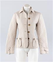 Sale 8760F - Lot 34 - A Max Mara Weekend quilted, belted jacket in grey with tortoiseshell buttons , size 10