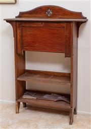 Sale 9071H - Lot 32 - An Arts & Crafts oak hall front bookcase with pierced floral back, (damage to foot) Height 150cm x Width 84cm x Depth 24cm