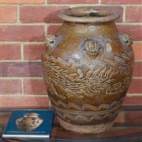 Sale 9080H - Lot 52 - An Indonesian baluster storage jar or Martaban with lion mask application with dragon and waves, together with a book by the ceramic...