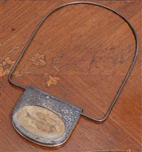 Sale 8963H - Lot 44 - A contemporary sterling silver necklace with a large pendant mounted with polished fish fossil, The drop 22.5cm  (poorly stamped to ...