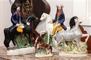 Sale 8804A - Lot 198 - Two similar ceramic statues of highwaymen, one stamped Dick Turpin, together with a ceramic zebra and a smaller statue of a rearing ...
