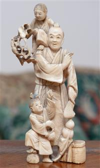 Sale 8963H - Lot 49 - A Meiji ivory okimono of an elderly smoker with two attendants, signed below hand, height 17cm