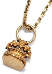 Sale 9046 - Lot 352 - AN ANTIQUE GOLD FOB ON GAURD CHAIN; 9ct vacant fob seal on a large gold plated ring surmount, height 41mm, wt. 13.39g, on a 136cm go...