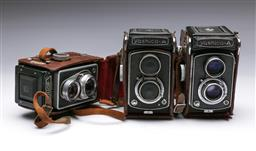 Sale 9093 - Lot 18 - A Set Of Three Vintage Cameras Including Two Yashica-A Cameras And A Rollop