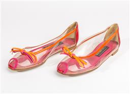 Sale 8685F - Lot 31 - A pair of Stuart Weitzman bow-tie slip ons in clear PVC with coloured leather trim, size 7M