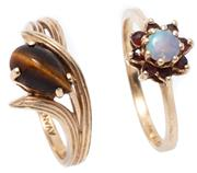 Sale 8991 - Lot 306 - TWO GOLD STONE SET RINGS; a 14ct set with opal and garnet cluster (worn), size N, wt. 2.32g, other 10ct with cabochon tigers eye, s...