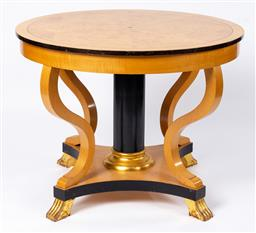 Sale 9130S - Lot 7 - An RD Kirkman maple circular centre table with ebonised column and paw feet Height 77cm x Diameter 103cm, some scratches