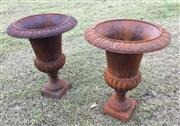 Sale 8579 - Lot 16 - A pair of large cast iron rustic urns with surface rust, H62 x Diameter 42cm