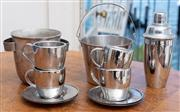 Sale 8990H - Lot 38 - An art deco ice bucket together with a modern cocktail shaker, stainless steel ice bucket and four Avanti cups and saucers