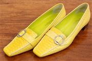 Sale 9066H - Lot 97 - A pair of Porta Rossa Italian made vibrant yellow leather square toe loafers with diamante circular buckle, Size 39