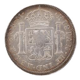 Sale 9130E - Lot 42 - A George III silver emergency coin over strike on Charles IV eight reales, dated 1796, weight 26.78g