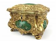 Sale 8995H - Lot 30 - A heavily decorated ormolu bronze  jewellery casket, with green insert and a lined mauve velvet interior, height 13cm x width 19cm x...