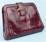 Sale 9083F - Lot 62 - A VINTAGE SNAKESKIN CLUTCH BAG; maroon leather trim, hidden gold tone chain shoulder strap, three internal compartments, central com...