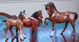 Sale 9103M - Lot 464 - A group of three glazed Beswick horse figures including Another Buno Height 15cm Length 20cm, rearing horse Length 19.5cm and a foal