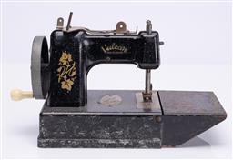 Sale 9190E - Lot 9 - A vintage Vulcan small sewing machine, Height 17cm x Length 28cm