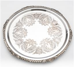 Sale 9245R - Lot 68 - A Strachan silverplate on copper circular salver, the scrolled and foliate centre framed by a shell, leaf and fluted rim. D: 36cm