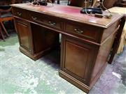 Sale 8653 - Lot 1070 - Late Victorian Walnut Desk, by Maple & Co (stamped to two drawers) with tooled red leather top, above three drawers & two panel doors