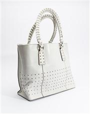 Sale 8685F - Lot 43 - A white leather perforated tote bag with woven straps, H 30 x W 36 x D 8cm