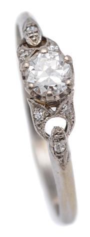 Sale 9074 - Lot 379 - A VINTAGE 18CT WHITE GOLD DIAMOND RING; set with an Old European cut diamond of approx. 0.26ct P1 to pierced shoulders set with a to...