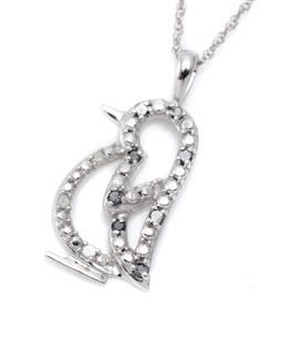 Sale 9246J - Lot 384 - A 10CT WHITE GOLD BLACK AND WHITE DIAMOND PENDANT NECKLACE; in the form of a penguin set with 3 white and 7 black single cut diamond...